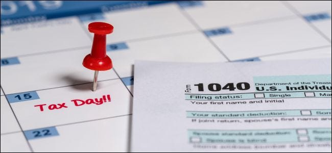 Calendar showing April 15th and a 1040 tax form