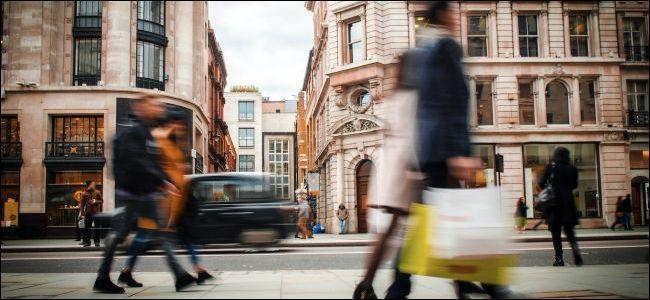 Blurred people in street