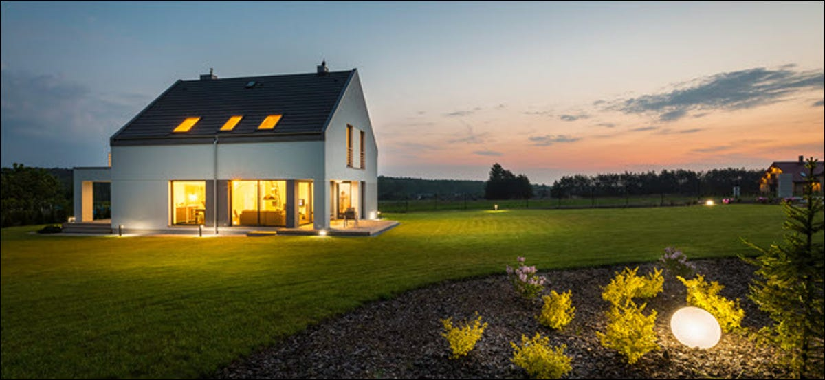 well lit home at dusk