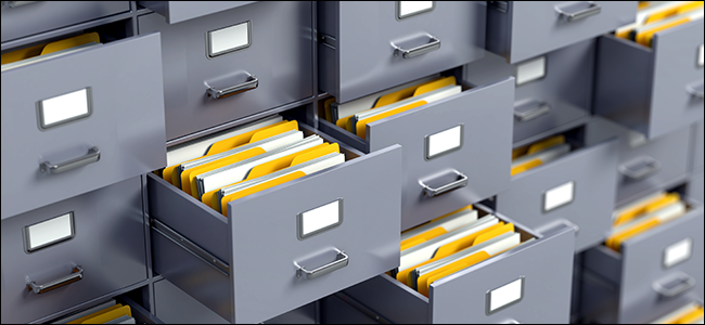 abstract filing cabinets bulging with files
