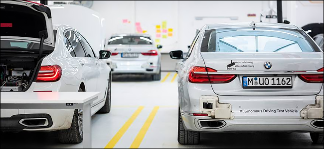 Three autonomous BMW cars in a factory