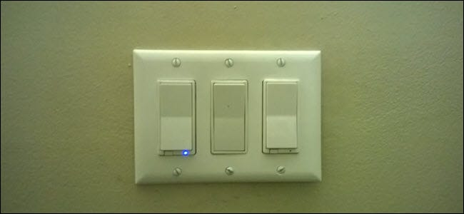 Two smart switches, and a standard paddle switch between them.