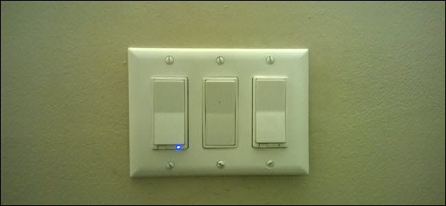 Three light switches, one with a blue light revealing that it is smart.