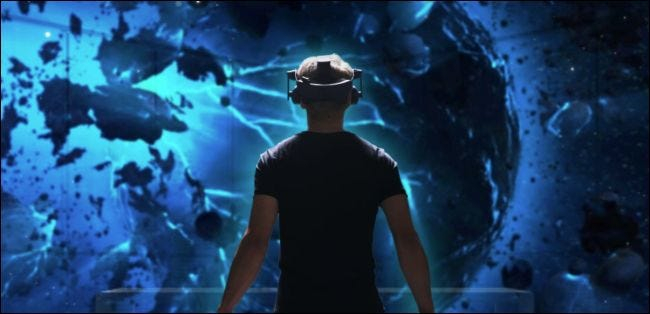 Man wearing an HTC Vive Pro headset