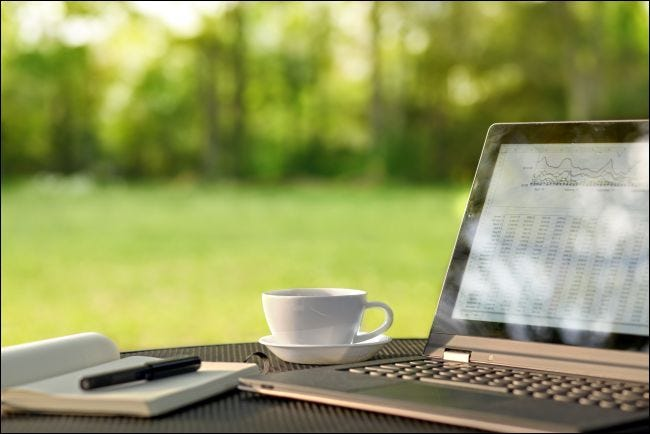 Laptop and coffee on a table outdoors