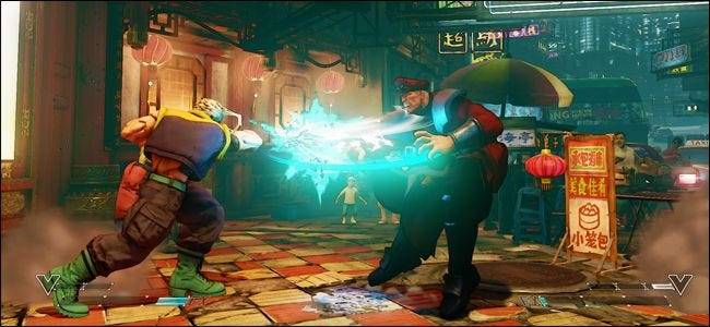 "A screenshot from ""Street Fighter"" showing one character striking another."