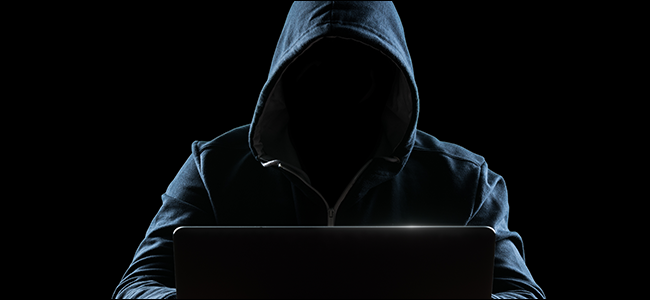 scary hacker in front of his laptop