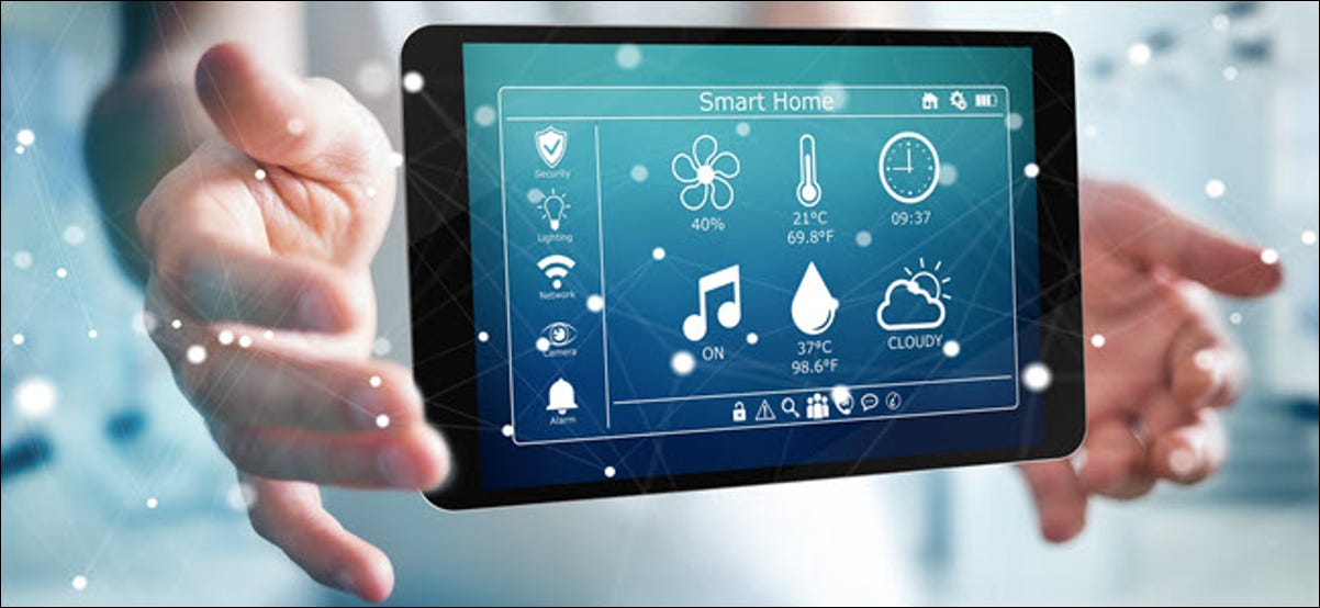 Hands holding a tablet with smart home functions displayed