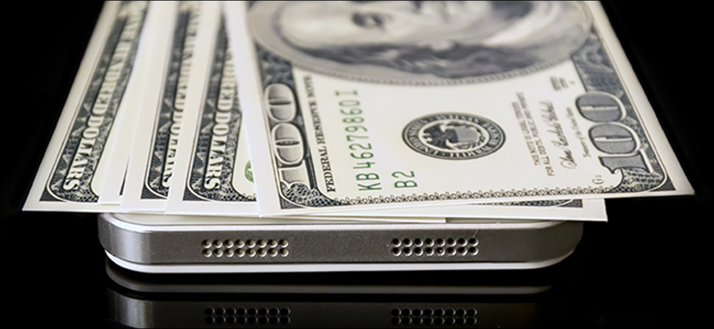 Hundred dollar bills resting on an iPhone