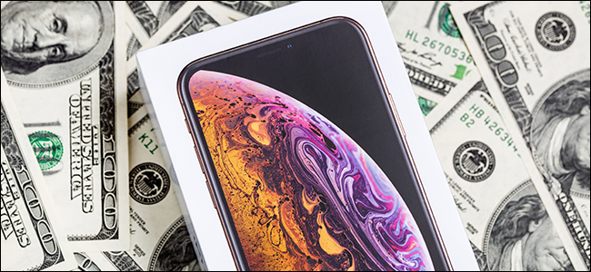 An iPhone X case on a pile of money