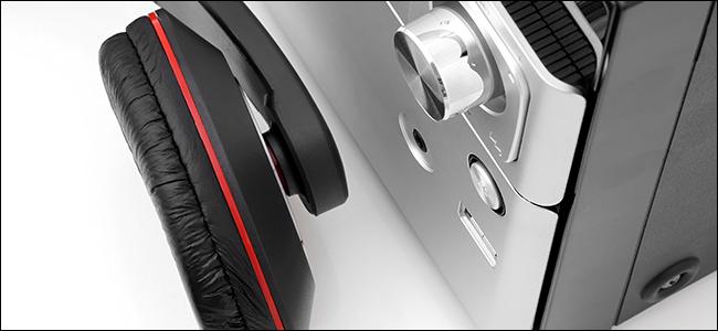 Headphones next to an amplifier