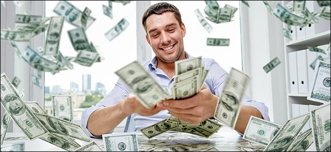 "A man fanning his money around to ""make it rain"""