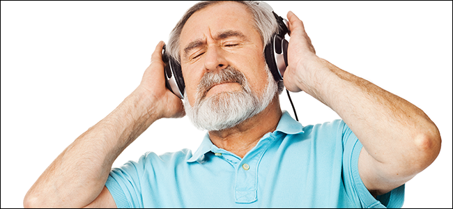 Older man truly appreciating the sound quality of his expensive headphones