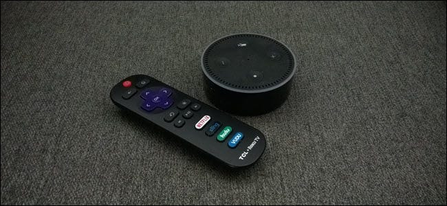 An Amazon Echo next to Roku remote
