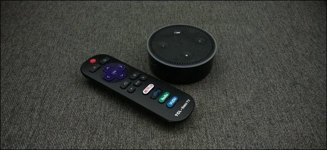 An Amazon Echo next to Roku remote