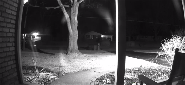 View of a camera behind a window at night with night vision on