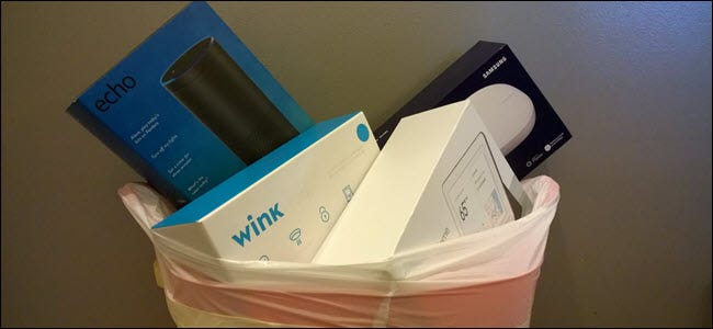 Echo, Wink, Samsung Smartthings, and Google home boxes in a trash can.