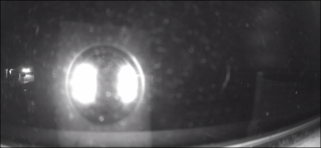 Wyze Cam with night vision LEDs lit, most of the picture is obscured by bright lights