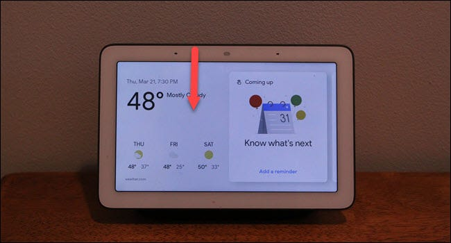 Google Home hub with down arrow drawn from top of the screen.