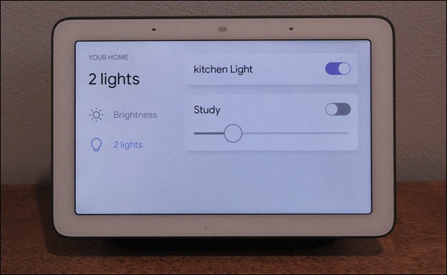 Google Home Hub with smart light controls on screen.