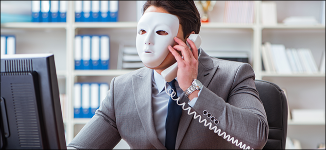 Businessman wearing a mask at a computer