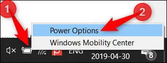 Right click the battery icon in the system tray, then click Power Options