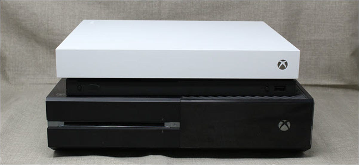 An Xbox One X on top of an original Xbox One