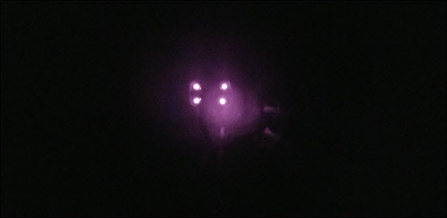 A darkened room with very visible bright purple lights.