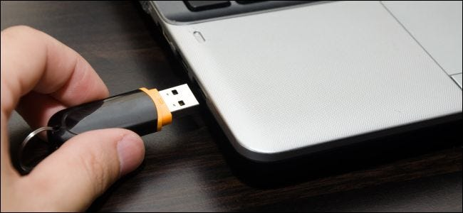 Plugging a USB drive into a PC laptop