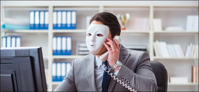 Businessman wearing a mask in an office