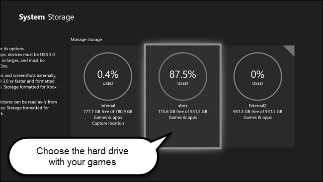 Menú de almacenamiento del sistema Xbox con llamadas en el disco duro que contiene juegos.