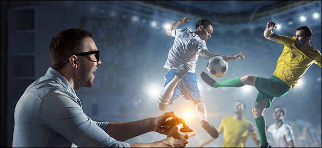 A gamer controls a real soccer game with his Xbox controller.