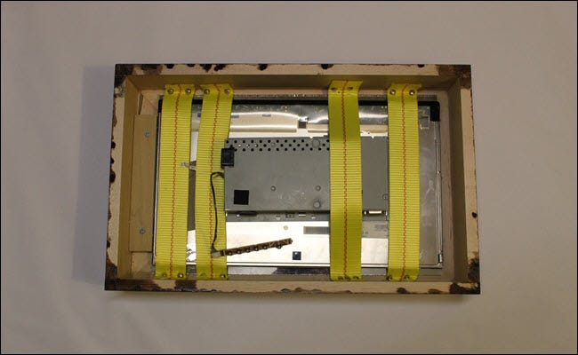 Frame box with monitor and glass strapped in.