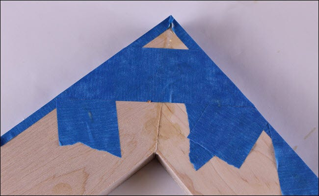 A frame corner with tape all around the edges.