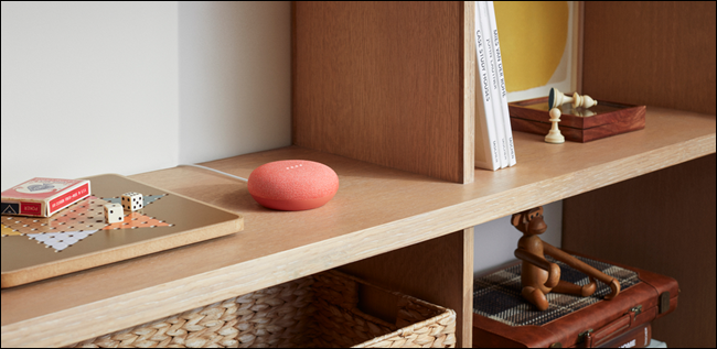 Red Google Home on a shelf.