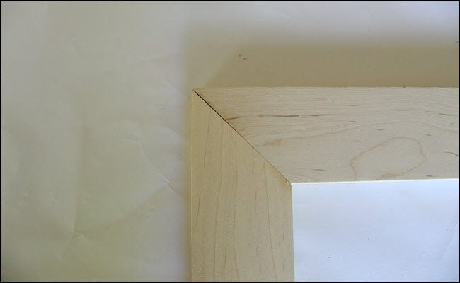 Two boards with angle cuts, forming a miter joint.