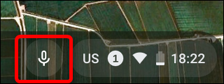 When the dictation feature is enabled, a microphone icon appears next to the system tray. Click on it to turn on dictation