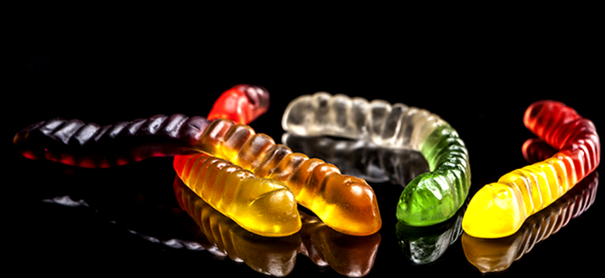 Jelly worms on a black background.