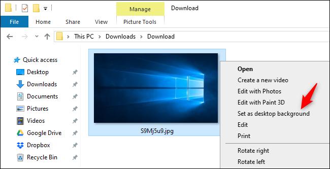 How to Get Windows 10's Old Default Desktop Background Back