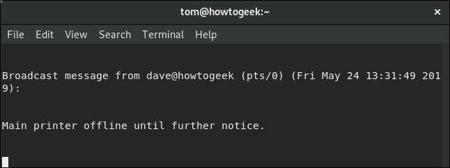 wall message to local user tom in a terminal window