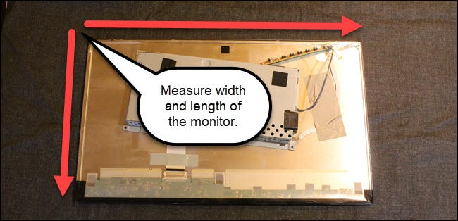 Monitor with arrows showing measurements of length and width.