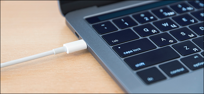 A laptop connected to a display via USB-C cable.