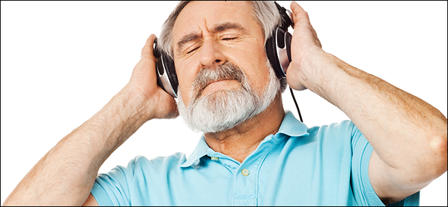 A man enjoying the sweet sound of his noise canceling headphones