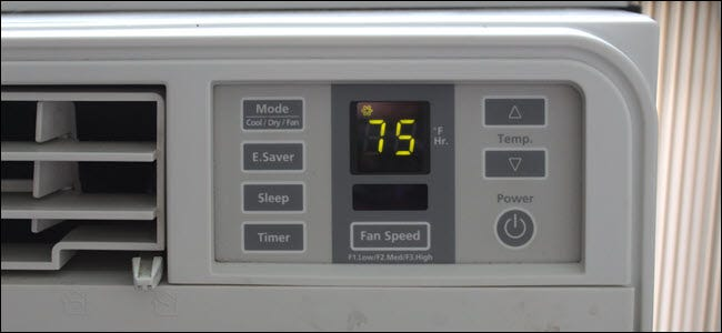 A closeup of an A/C unit showing an electrical switch and LED screen.