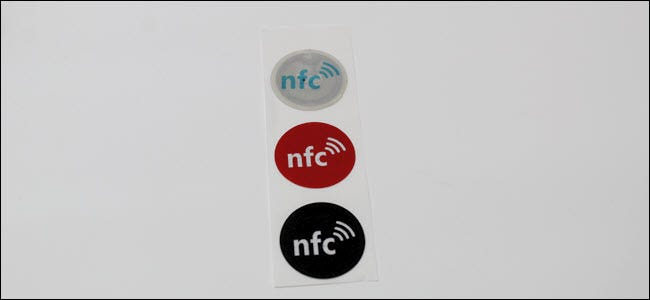 Three NFC tags on a paper strip.