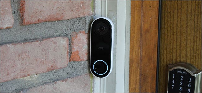 A Nest Hello Video Doorbell with button light glowing.