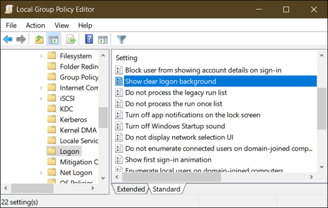 Locate Show clear logon background in the right pane and double-click on it.