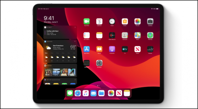 iPadOS home screen in dark mode showing widgets