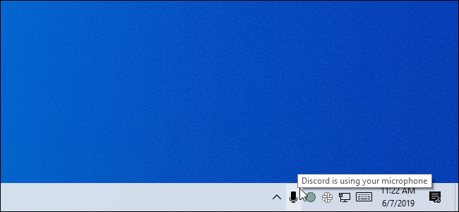 Mousing over the microphone icon in the May 2019 Update's system tray
