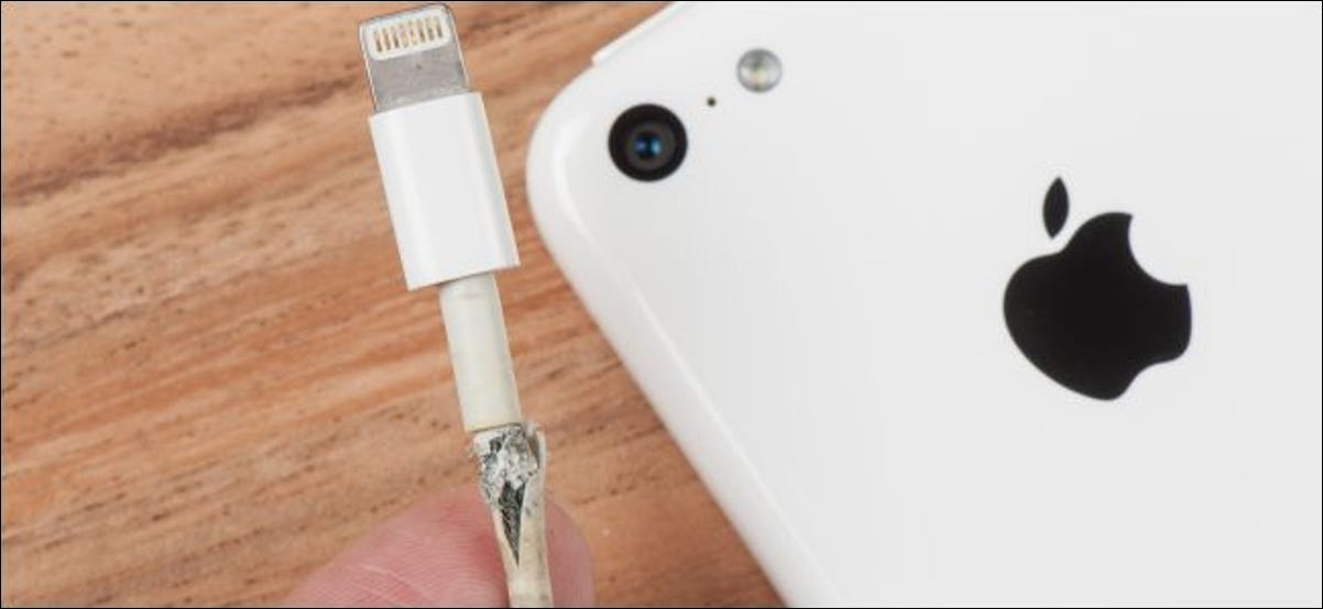Broken lightning charging cable with an iPhone